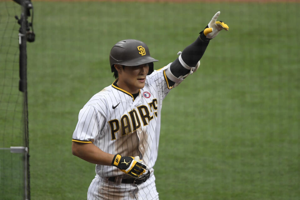 San Diego Padres' Ha-Seong Kim (7) points skyward after hitting a solo home run during the second inning of a baseball game against the St. Louis Cardinals, Saturday, May 15, 2021, in San Diego. (AP Photo/Denis Poroy)