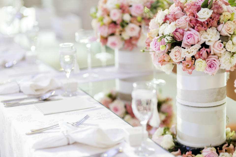 The furious mother took to Mumsnet to ask other what they thought, after her son and his bride put her sitting next to her ex-husband on the top table on the day. Photo: Getty Images