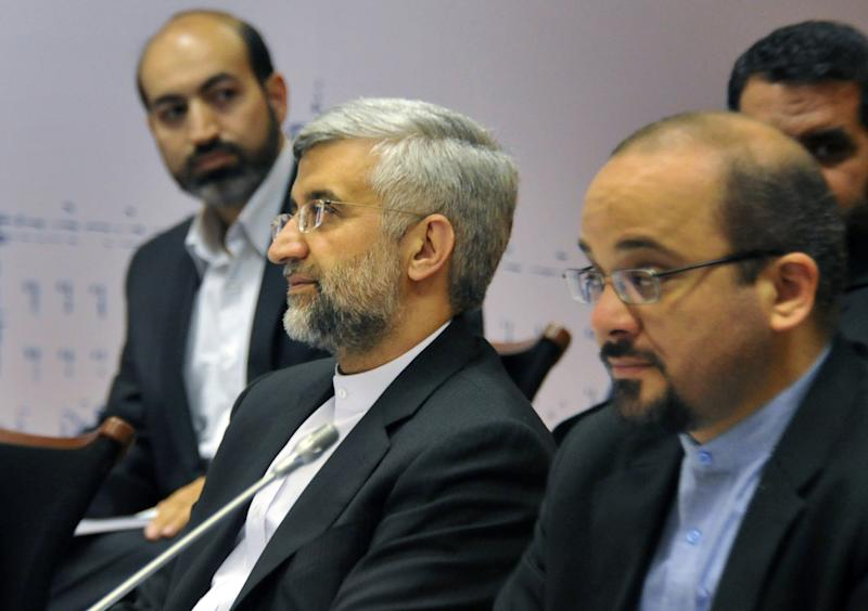 Chief Iranian nuclear negotiator Saeed Jalili, center, and EU foreign policy chief Catherine Ashton, not pictured, take part in the talks on the controversial Iranian nuclear programme in Moscow, on Tuesday, June 19, 2012. Iran and six world powers have started a second day of meetings as they try to break a deadlock at talks focused on reducing fears about Tehran's nuclear intentions. (AP Photo/Alexander Nemenov, pool)