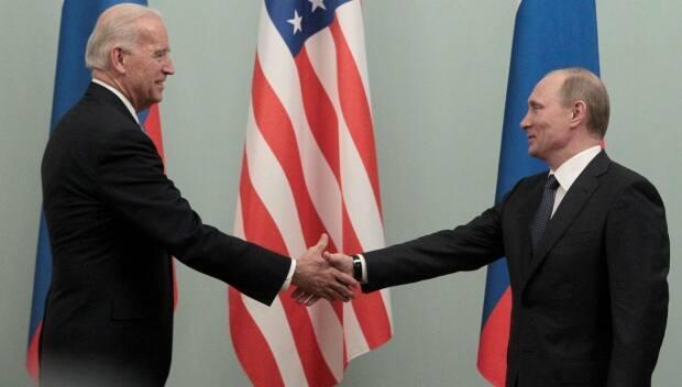 Russian President Vladimir Putin, right, seen here in 2011, has been accused of interfering in two U.S. elections. This week, U.S. President Joe Biden, left, called him a killer. Putin recalled his ambassador from the U.S.