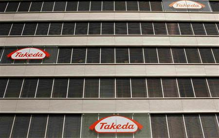 File photo of logos of Takeda Pharmaceutical Co at an office building in Glattbrugg