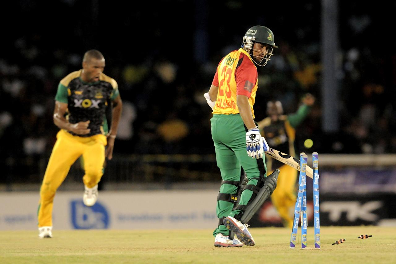 PORT OF SPAIN, TRINIDAD AND TOBAGO - AUGUST 24:  Tillakaratne Dilshan of Guyana Amazon Warriors bowled by Jamaica Tallawahs Dave Bernard Jnr. (L) during the Final of the Caribbean Premier League between Guyana Amazon Warriors v Jamaica Tallawahs at Queens Park Oval on August 24, 2013 in Port of Spain, Trinidad and Tobago. (Photo by Randy Brooks/Getty Images Latin America for CPL)