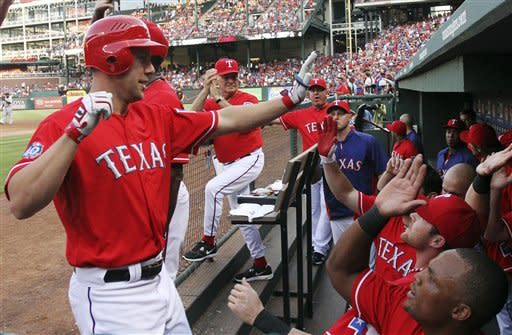 Texas Rangers' David Murphy (7) celebrates his two-run home run in the second inning against the Detroit Tigers during a baseball game in Arlington, Texas, Wednesday, June 27, 2012. (AP Photo/Richard Rodriguez)