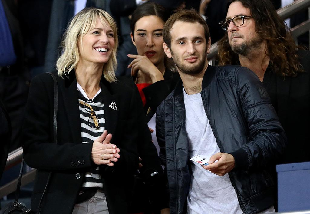 <p>Robin Wright was at the same game as Kourtney, but we don't think she wanted to kiss her date — except in a mom way. The <em>House of Cards</em> star brought along her son, Hopper Penn. (Photo: Best Image/BACKGRID) </p>