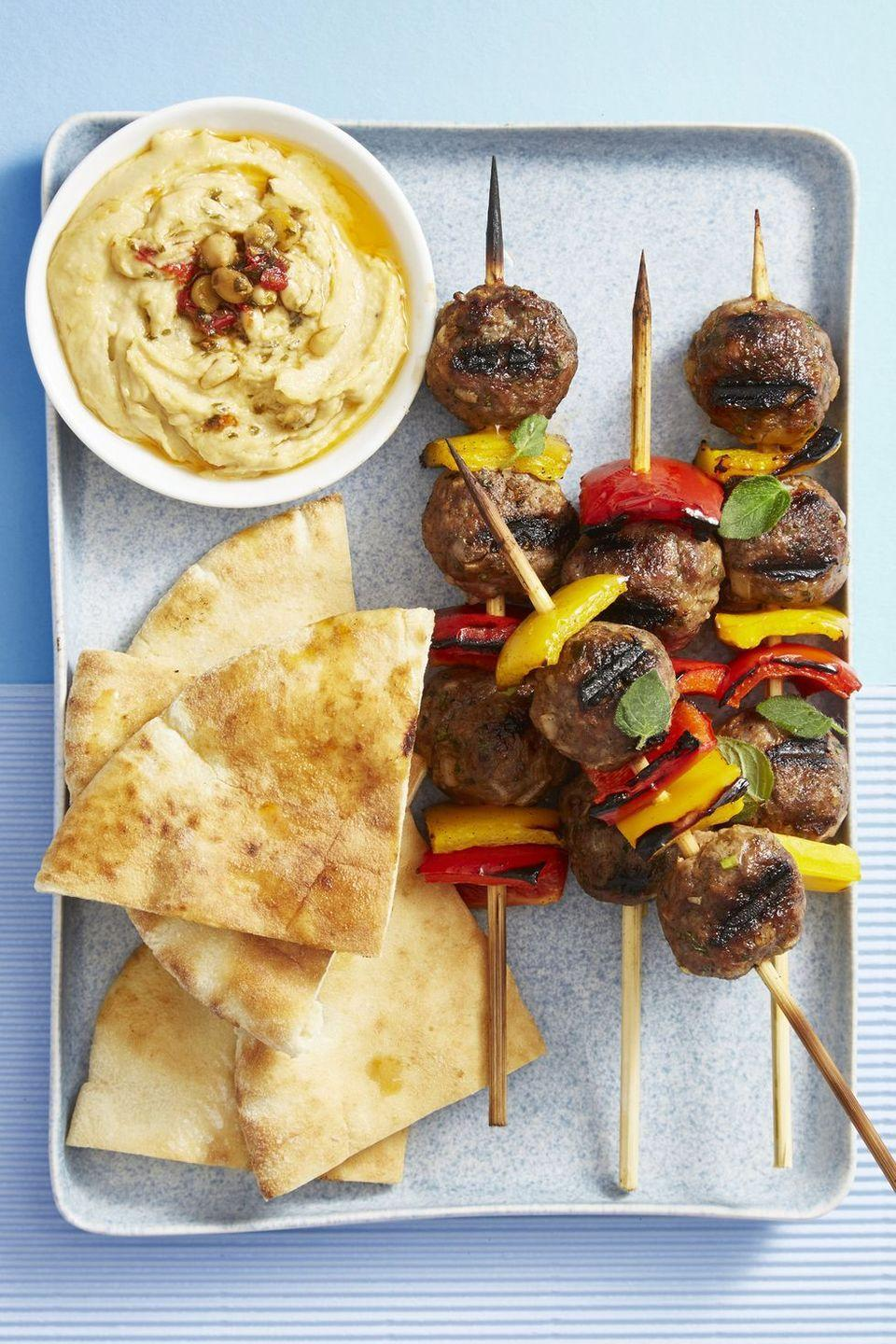 """<p>Kababs are the perfect finger foods because, well, your guests don't have to dirty their fingers to eat them. Spicy lamb meatballs make these feel elevated — without any extra work on your end. </p><p><em><a href=""""https://www.goodhousekeeping.com/food-recipes/easy/a44727/grilled-lamb-meatball-pepper-skewers-recipe/"""" rel=""""nofollow noopener"""" target=""""_blank"""" data-ylk=""""slk:Get the recipe for Grilled Lamb Meatball Pepper Skewers »"""" class=""""link rapid-noclick-resp"""">Get the recipe for Grilled Lamb Meatball Pepper Skewers »</a></em> </p>"""