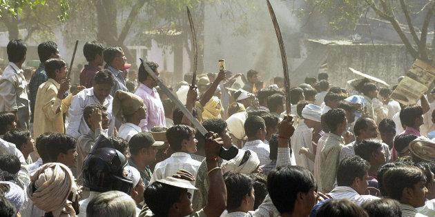 A 2002 photo of a Hindu mob waving swords during communal riots in Ahmedabad.