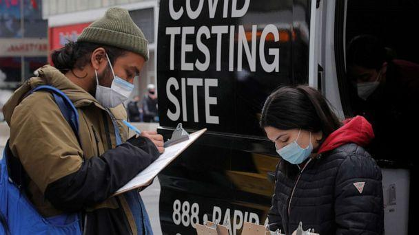 PHOTO: A man signs up to take a COVID-19 test at a mobile testing van in Herald Square in New York, March 16, 2021. (Brendan Mcdermid/Reuters)
