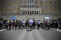 Tourists gather in front of the parliament building in Athens, Greece June 29, 2015. REUTERS/Alkis Konstantinidis