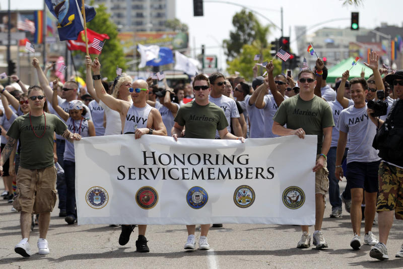 FILE - This July 16, 2011 file photo shows members of the military marching in the Gay Pride Parade in San Diego. The Defense Department on Thursday, July 19, 2012 announced it is allowing service members to march in uniform in a gay pride parade for the first time in U.S. history. The department said it was making the exception for Saturday's Gay Pride Parade in San Diego because organizers had encouraged military personnel to march in their uniform and the event was getting national attention. (AP Photo/Gregory Bull, File)