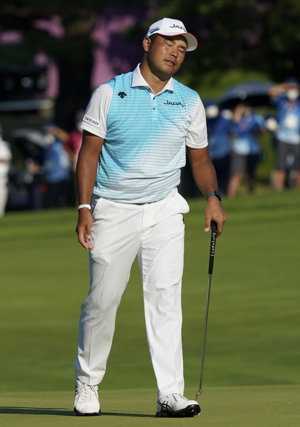 Hideki Matsuyama of Japan reacts after missing a putt during a bronze medal playoff of the men's golf event at the 2020 Summer Olympics on Sunday, Aug. 1, 2021, in Kawagoe, Japan. (AP Photo/Matt York)