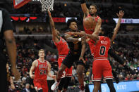 Cleveland Cavaliers' Collin Sexton (2) passes the ball as Chicago Bulls' Coby White (0), Daniel Gafford (12), Shaquille Harrison (3) and Lauri Markkanen (24) defend during the first half of an NBA basketball game Tuesday, March 10, 2020, in Chicago. (AP Photo/Paul Beaty)