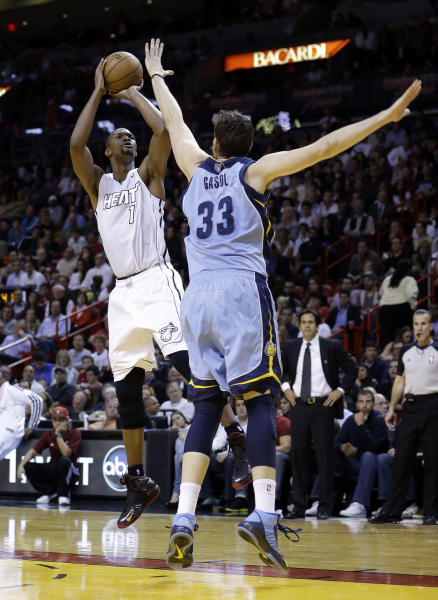 Miami Heat's Chris Bosh (1) prepares to shoot against Memphis Grizzlies' Marc Gasol (33) in the first half of an NBA basketball game in Miami, Friday, March 1, 2013. (AP Photo/Alan Diaz)
