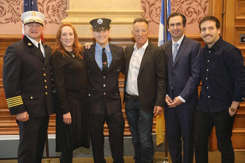 Sam Springsteen with his parents and Jersey City Mayor Steven Fulop.
