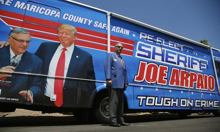 Joe Arpaio in front of his 2020 campaign vehicle.