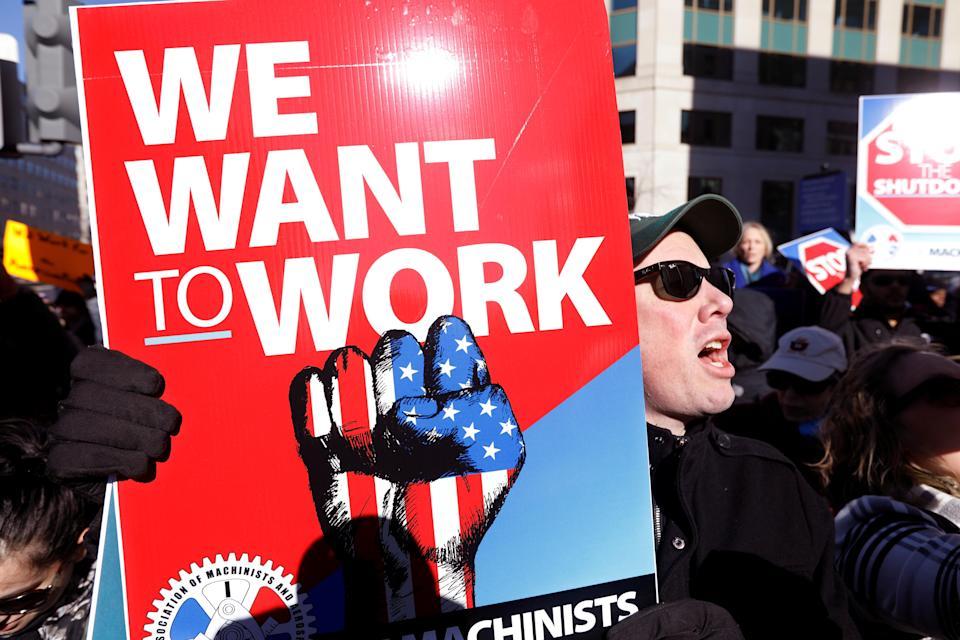 """Federal government workers and other demonstrators march during a """"Rally to End the Shutdown"""" in Washington, D.C., Jan.10, 2019. (Photo: Kevin Lamarque/Reuters)"""