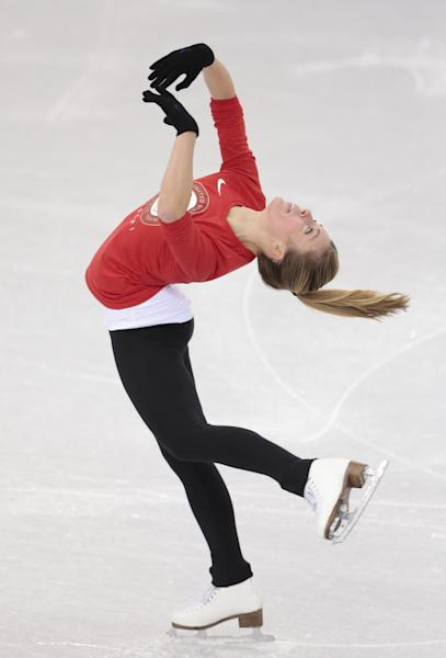 Ashley Wagner, of the United States, skates at the figure stating practice rink ahead of the 2014 Winter Olympics, Wednesday, Feb. 5, 2014, in Sochi, Russia. (AP Photo/Ivan Sekretarev)