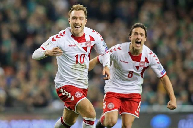 Denmark's midfielder Christian Eriksen celebrates with midfielder Thomas Delaney (R) after scoring a goal during the FIFA World Cup 2018 qualifying football match against Ireland November 14, 2017 (AFP Photo/Paul FAITH)