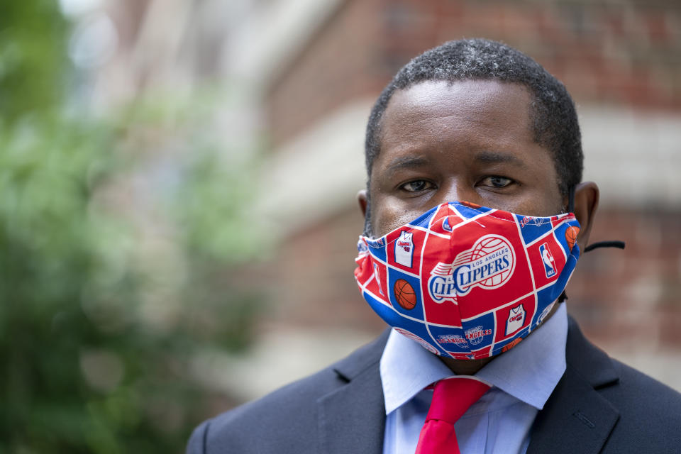 Economist Gbenga Ajilore poses for a photo outside his home in Washington, Friday, June 19, 2020. Ajilore believes the coronavirus pandemic is affecting the two largest U.S. generations, Baby Boomers and Millennials. For baby boomers, named for the post-World War II surge of births, that means those who retired or are nearing retirement age are seeing their retirement accounts appearing unreliable while their health is at high risk. Millennials, who became young adults in this century, are getting socked again as they were still recovering from the Great Recession. (AP Photo/J. Scott Applewhite)