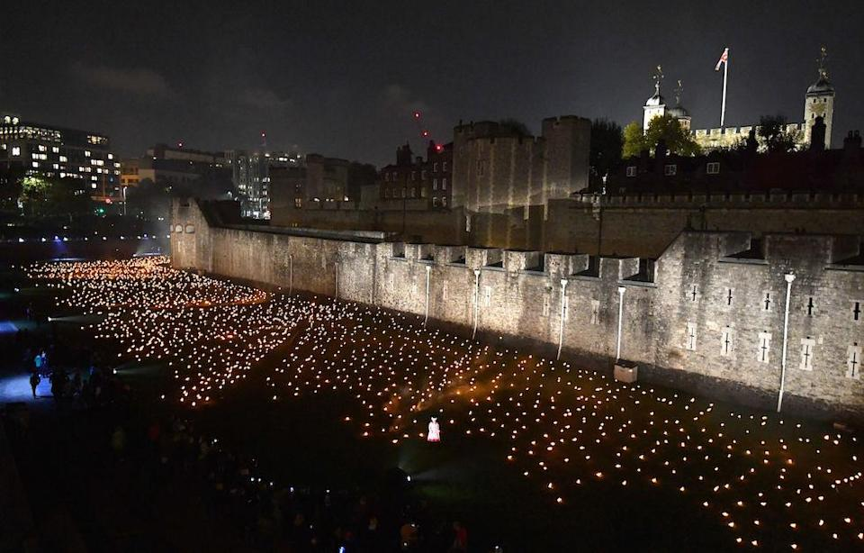 <p>The first of thousands of flames in the dry moat of the Tower of London as part of an installation called Beyond the Deepening Shadow: The Tower Remembers, to mark the centenary of the end of First World War. (Picture: PA) </p>