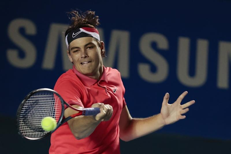 Taylor Fritz of the U.S. returns a ball in his quarterfinal match against Kyle Edmund of Great Britain.