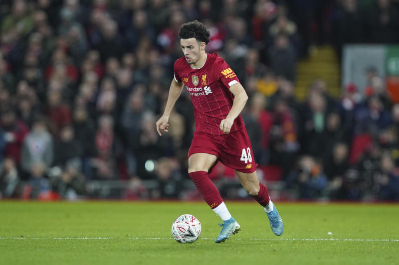 Liverpool's Curtis Jones controls the ball during the English FA Cup third round soccer match between Liverpool and Everton at Anfield stadium in Liverpool, England, Sunday, Jan. 5, 2020. (AP Photo/Jon Super)