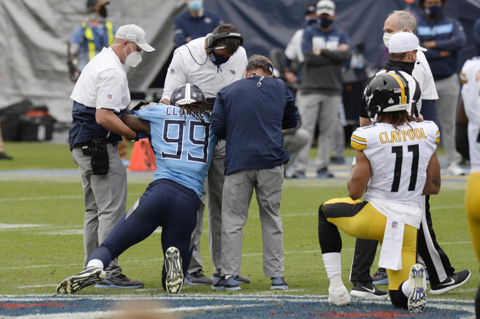 Tennessee Titans linebacker Jadeveon Clowney (99) is helped up after being injured in the second half of an NFL football game against the Pittsburgh Steelers Sunday, Oct. 25, 2020, in Nashville, Tenn. (AP Photo/Mark Zaleski)