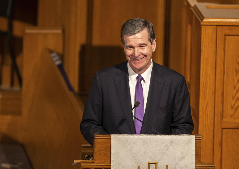 Gov. Roy Cooper speaks during the memorial service for former U.S. Sen. Kay Hagan at First Presbyterian Church, Sunday, Nov. 3, 2019, in Greensboro, N.C. Hagan died Monday, Oct. 28 of a rare virus, at the age of 66. (Khadejeh Nikouyeh/News & Record via AP)