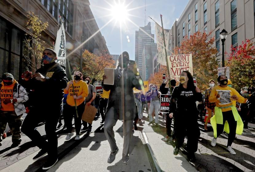 PHILADELPHIA, PA.- NOV. 5, 2020. Anti-Trump protesters dance outside the Philadelphia Convention Center, where counting of ballots for the 2020 presidential election continued on Thursday, Nov. 5, 2020. (Luis Sinco / Los Angeles Times)