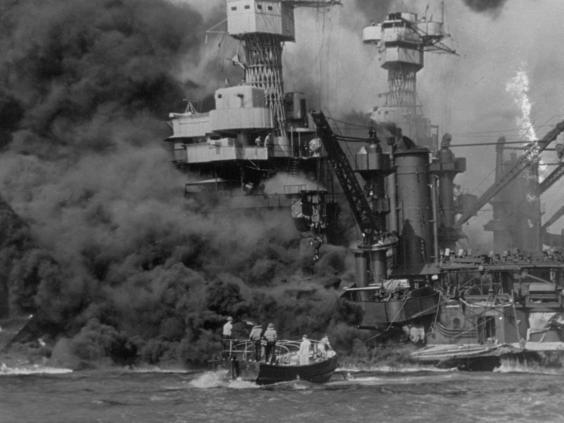 A small boat rescues sailors from the USS 'West Virginia', Doris Miller's ship, after she had suffered a hit (Getty Images)