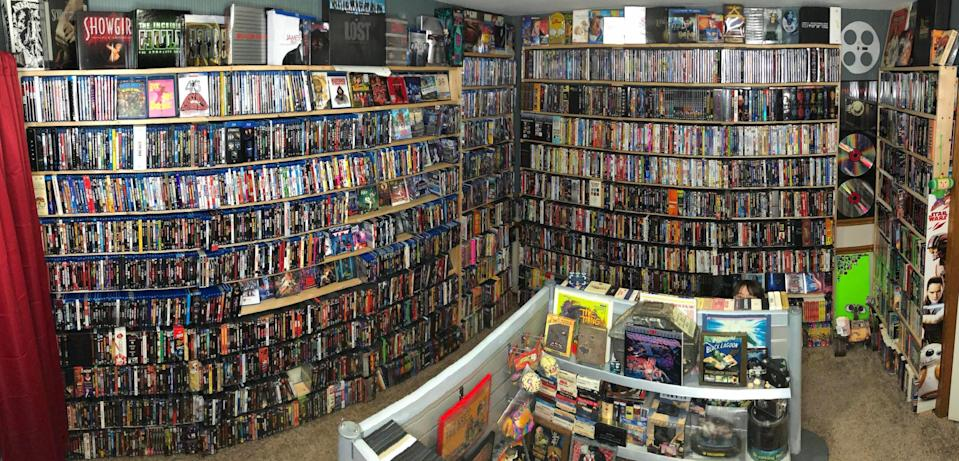 bookshelves hold DVDs and Blu-Rays