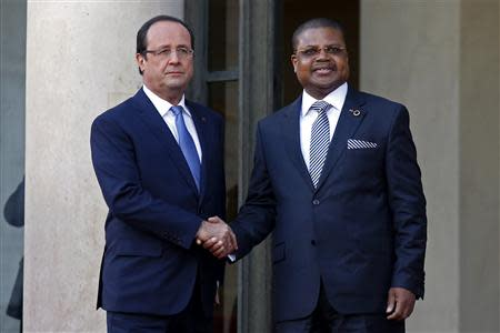France's President Hollande greets Prime Minister of the Central African Republic Nicolas Tiangaye in the courtyard of the Elysee Palace at the start of the Elysee Summit for Peace and Security in Africa, in Paris