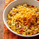 <p>If you like cheese, you'll love this vegetable side dish. Sweet peppers--both red and green--and sweet yellow corn are slow-cooked, topped with a creamy, blue cheese sauce and sprinkled with shredded cheddar. It's decadently delicious!</p>