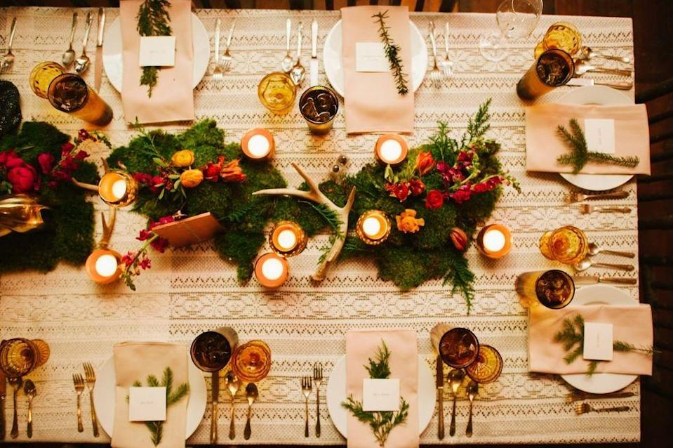 """<p>Gather your near and dear ones close as the clock strikes midnight, and watch them linger around the table thanks to your inviting decor. A lacy table cloth pairs beautifully with an all-natural centerpiece and lots of glowing votives, via <a rel=""""nofollow noopener"""" href=""""http://rebekahjmurray.com/"""" target=""""_blank"""" data-ylk=""""slk:Rebekah J. Murray Photography"""" class=""""link rapid-noclick-resp"""">Rebekah J. Murray Photography</a>.</p>"""
