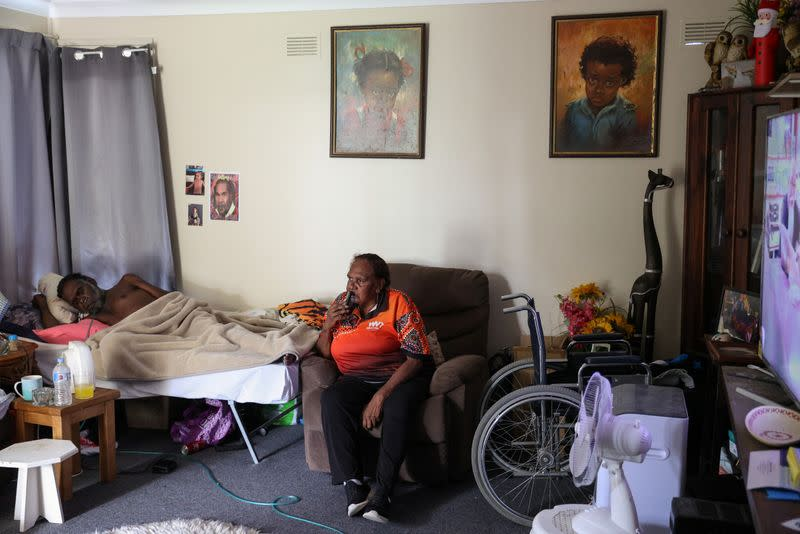 Indigenous Muruwari elder Rita Wright is seen at home with her son in Sydney