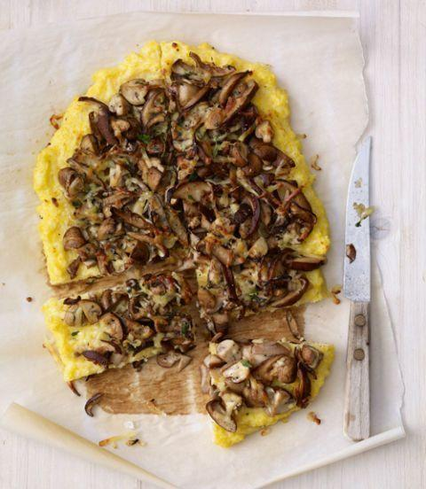 """<p>A great twist on traditional pizza that also happens to be gluten-free — ideal for anyone with food sensitivities. </p><p><em><a href=""""https://www.womansday.com/food-recipes/food-drinks/recipes/a11293/cheesy-polenta-and-mushroom-pizza-recipe/"""" rel=""""nofollow noopener"""" target=""""_blank"""" data-ylk=""""slk:Get the Cheesy Polenta & Mushroom Pizza recipe."""" class=""""link rapid-noclick-resp"""">Get the Cheesy Polenta & Mushroom Pizza recipe.</a></em></p>"""