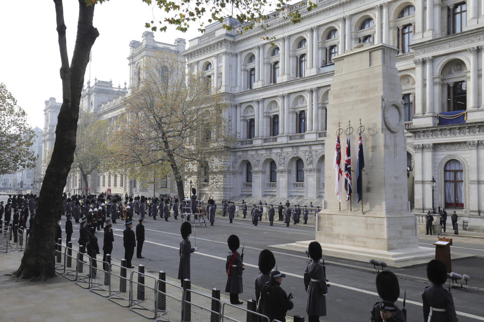 Representatives of the armed forces wait for the start of the Remembrance Sunday service at the Cenotaph, in Whitehall, London, Sunday Nov. 8, 2020. (Aaron Chown, Pool Photo via AP)