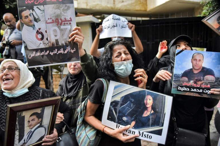 Demonstrators and families of the Beirut blast victims chant slogans during a protest on July 13