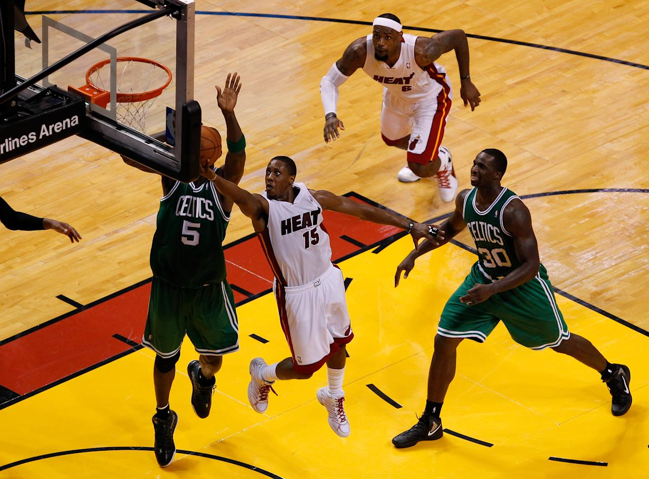 MIAMI, FL - JUNE 09:  Mario Chalmers #15 of the Miami Heat goes up for a shot against Kevin Garnett #5 of the Boston Celtics in Game Seven of the Eastern Conference Finals in the 2012 NBA Playoffs on June 9, 2012 at American Airlines Arena in Miami, Florida. NOTE TO USER: User expressly acknowledges and agrees that, by downloading and or using this photograph, User is consenting to the terms and conditions of the Getty Images License Agreement.  (Photo by J. Meric/Getty Images)