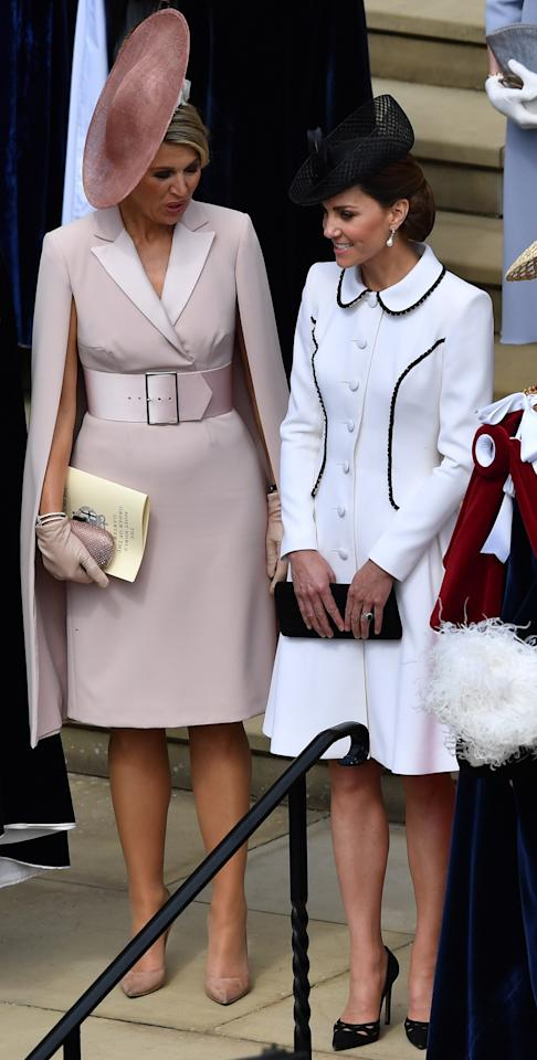 For the Order of the Garter service, Kate wore a white Catherine Walker coat dress with black piping with a Lock & Co hat, her black Prada pumps, Stuart Weitzman clutch and Princess Diana's Collingwood pearl earrings. <em>[Photo: PA]</em>