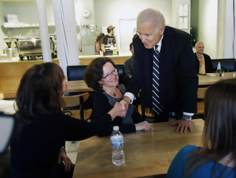 Vice President Joe Biden greets women who have either signed up for coverage or have helped others sign up for insurance under the federal health care law during a stop at Moose and Sadie's coffee shop Wednesday, Feb. 19, 2014, in Minneapolis. (AP Photo/Jim Mone,Pool)