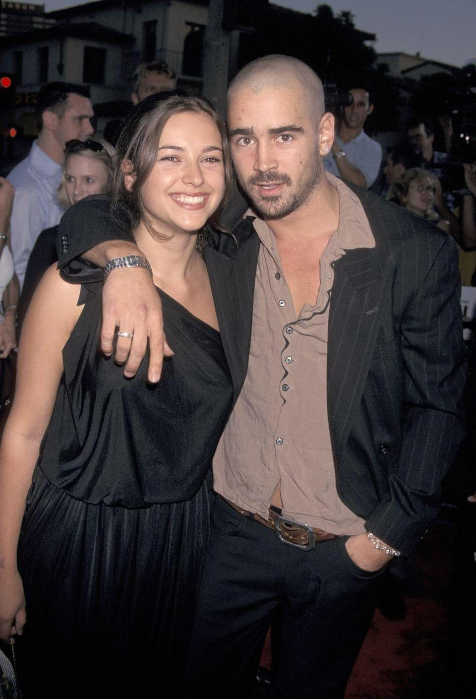 """<p>Back in 2001, when Colin was 25, he wed English actress Amelia, then 19. They separated after six months (and Amelia went on to marry Jamie Dornan), but Amelia claims the marriage was never legal. <a href=""""https://us.blastingnews.com/showbiz-tv/2017/07/jamie-dornans-wife-amelia-warner-says-marriage-to-colin-farrell-wasnt-legal-001825353.html"""" rel=""""nofollow noopener"""" target=""""_blank"""" data-ylk=""""slk:She told"""" class=""""link rapid-noclick-resp"""">She told </a><em><a href=""""https://us.blastingnews.com/showbiz-tv/2017/07/jamie-dornans-wife-amelia-warner-says-marriage-to-colin-farrell-wasnt-legal-001825353.html"""" rel=""""nofollow noopener"""" target=""""_blank"""" data-ylk=""""slk:The Sun"""" class=""""link rapid-noclick-resp"""">The Sun</a></em>, """"We had a ceremony on a beach in Tahiti that was by no means legal and we knew it wasn't....It was just a thing we did on holiday.""""</p>"""