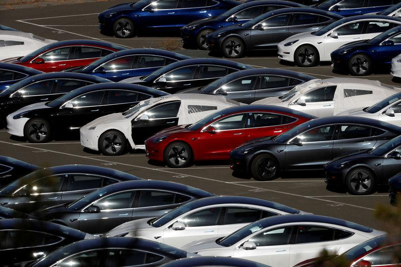 FILE PHOTO: Rows of new Tesla Model 3 electric vehicles are seen in Richmond, California.