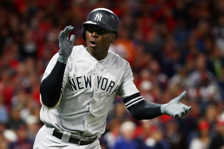 Didi Gregorius of the New York Yankees celebrates as he runs the bases after hitting a solo home run in the first inning against the Cleveland Indians, in game five of the American League Divisional Series, in Cleveland, Ohio, on October 11, 2017