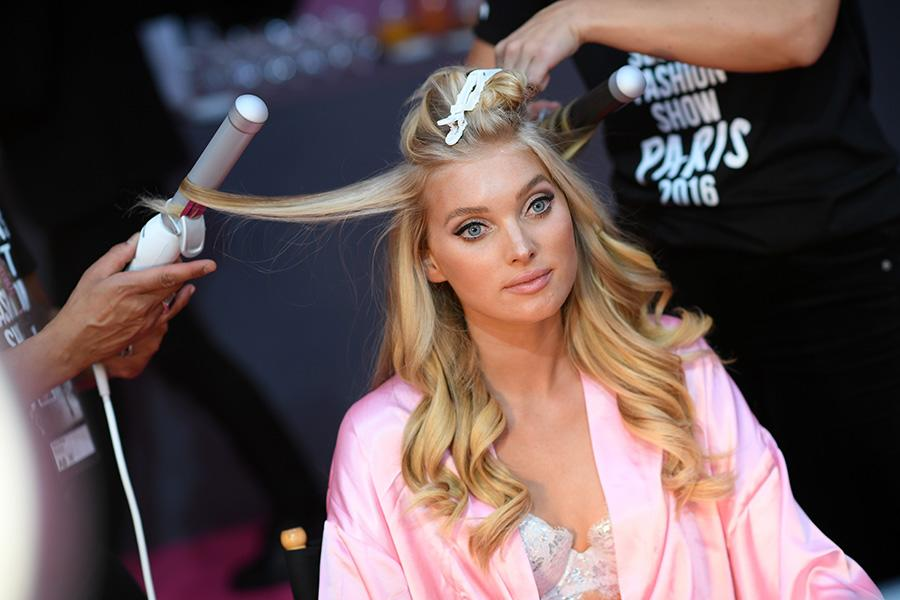 <p>Elsa Hosk's blonde hair was made sexy and tousled thanks to hairstylist Sarah Potempa's popular curling iron. <em>(Photo: Getty Images)</em> </p>