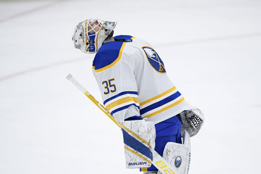 Buffalo Sabres goaltender Linus Ullmark (35) reacts after an NHL hockey game against the Washington Capitals, Sunday, Jan. 24, 2021, in Washington. The Sabres won 4-3 in a shootout. (AP Photo/Nick Wass)