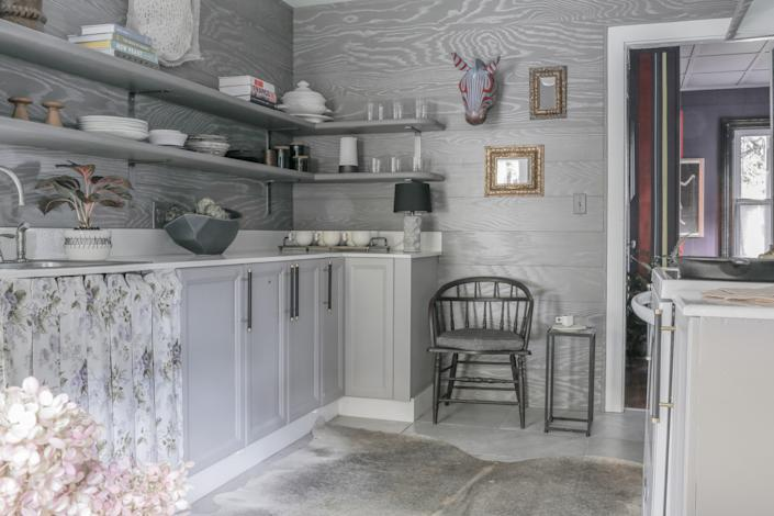 """<div class=""""caption""""> <strong>AFTER</strong>: The box-pleated sink skirt """"is one of my favorite things,"""" Maryline says. """"I was trying to reimagine what people would expect to see in a Victorian kitchen, so I used a very feminine floral fabric but then added box-pleats—instead of being flouncy, it looks very tailored."""" The leather-wrapped <a href=""""http://jayteske.com/"""" rel=""""nofollow noopener"""" target=""""_blank"""" data-ylk=""""slk:cabinet door pulls"""" class=""""link rapid-noclick-resp"""">cabinet door pulls</a> add a hint of rustic warmth to the kitchen. </div>"""
