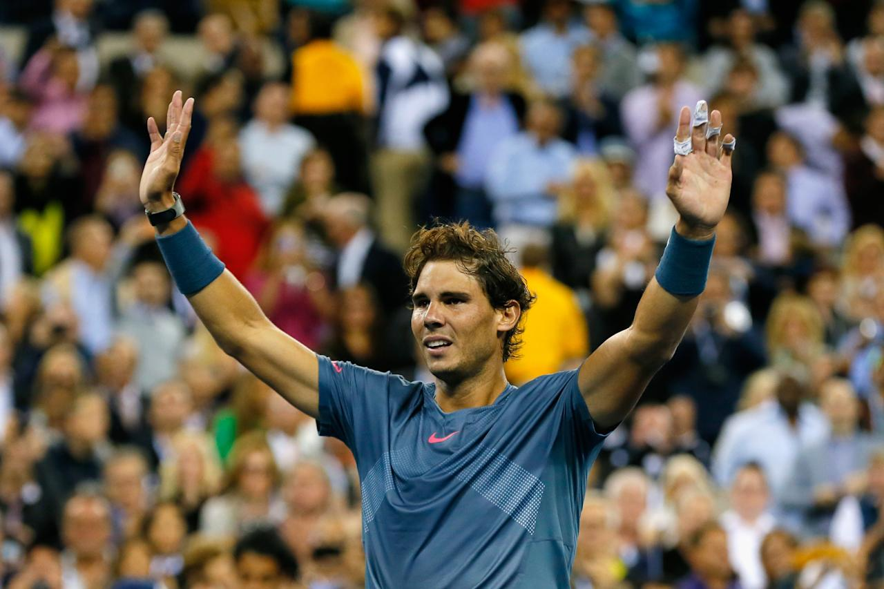 NEW YORK, NY - SEPTEMBER 09: Rafael Nadal of Spain celebrates winning the men's singles final match against Novak Djokovic of Serbia on Day Fifteen of the 2013 US Open at the USTA Billie Jean King National Tennis Center on September 9, 2013 in the Flushing neighborhood of the Queens borough of New York City. (Photo by Mike Stobe/Getty Images for the USTA)