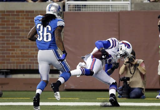 Buffalo Bills wide receiver Steve Johnson (13) catches a 4-yard touchdown pass in the endzone as Detroit Lions cornerback Jonte Green (36) watches in the first quarter of their NFL preseason football game in Detroit, Thursday, Aug. 30, 2012. (AP Photo/Paul Sancya)