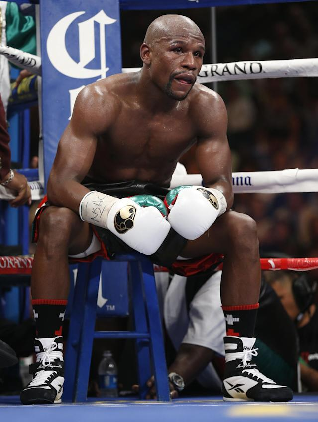 Floyd Mayweather Jr. sits in his corner during his WBC-WBA welterweight title boxing fight against Marcos Maidana Saturday, May 3, 2014, in Las Vegas. (AP Photo/Eric Jamison)