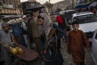 Taliban fighters patrol a market in Kabul's Old City, Afghanistan, Tuesday, Sept. 14, 2021. (AP Photo/Bernat Armangue)